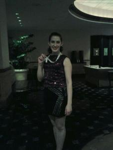 Posing with my medal after winning my company's talent show last year